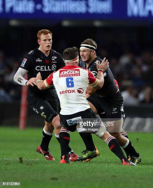 Jaco Kriel of the Emirates Lions looks to stop Andre Esterhuizen of the Cell C Sharks during the Super Rugby match between Cell C Sharks and Emirates...