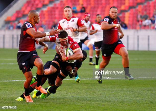 Jaco Kriel of the Lions is tackled by Malcomb Jaer of the Southern Kings during the Super Rugby match between Southern Kings and Emirates Lions at...