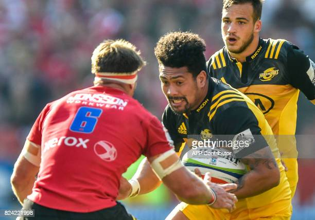 Jaco Kriel of the Lions waits to tackle Ardie Savea of the Hurricanes during the Super Rugby semifinal match between Lions and Hurricanes at Ellis...