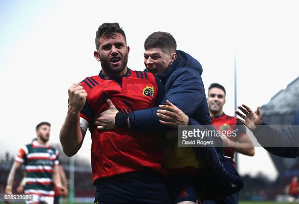 Jaco Taute of Munster celebrates with replacement Jack O'Donoghue after scoring a try during the European Champions Cup match between Munster and...