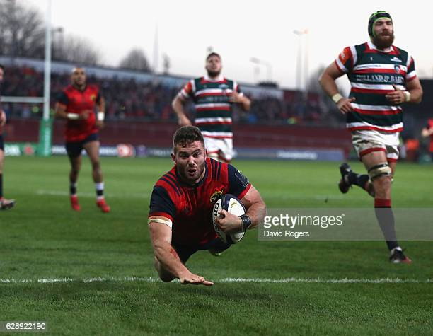 Jaco Taute of Munster dives in for a try during the European Champions Cup match between Munster and Leicester Tigers at Thomond Park on December 10...