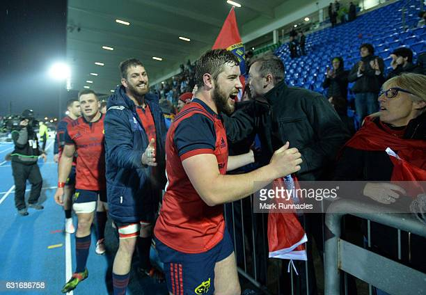 Jaco Taute of Munster Rugby is congratulated by Munster supporters in the main stand at the final whistle as Munster beat Warriors 1412 during the...