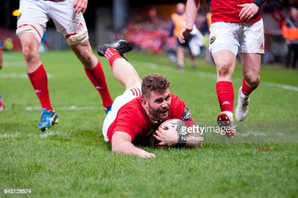 Jaco Taute of Munster scores a try during the Guinness PRO12 Round 16 match between Munster Rugby and Scarlets at Thomond Park Stadium in Limerick...