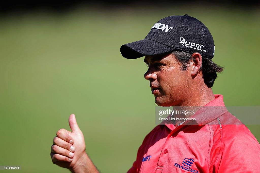 Jaco van Zyl of South Africa gives a thumbs up after he finished on the 8th green during Day One of the Africa Open at East London Golf Club on February 14, 2013 in East London, South Africa.
