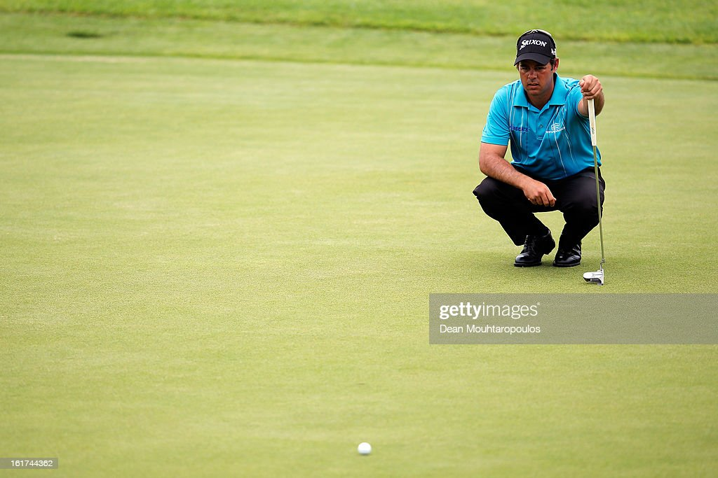 Jaco van Zyl of South Africa line up his putt on the 3rd green during Day Two of the Africa Open at East London Golf Club on February 15, 2013 in East London, South Africa.
