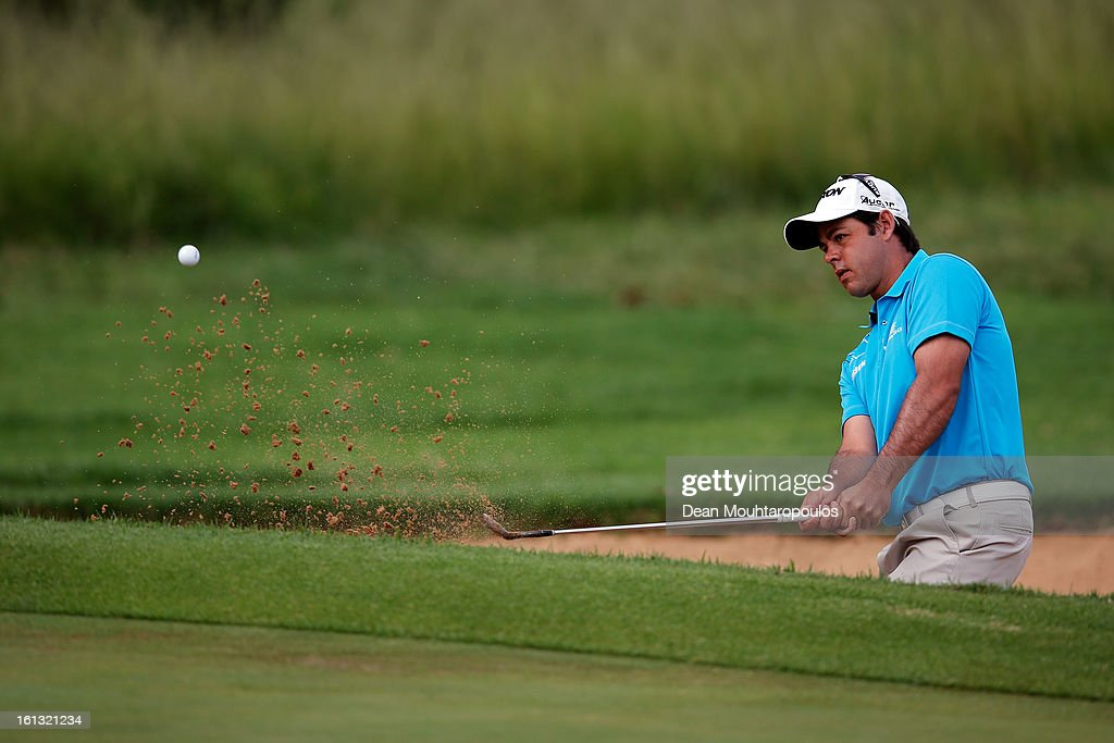 Jaco Van Zyl of South Africa out of the bunker onto the 1st green during the Final Round of the Joburg Open at Royal Johannesburg and Kensington Golf Club on February10, 2013 in Johannesburg, South Africa.