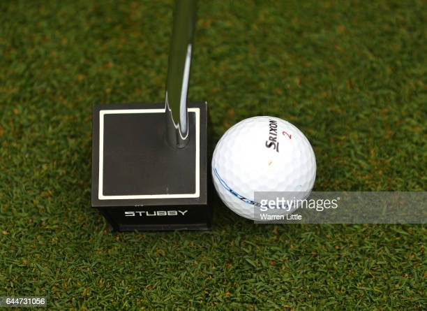 Jaco Van Zyl of South Africa putts with his new small square headed putter during completion of the rain delayed first round of the Joburg Open at...
