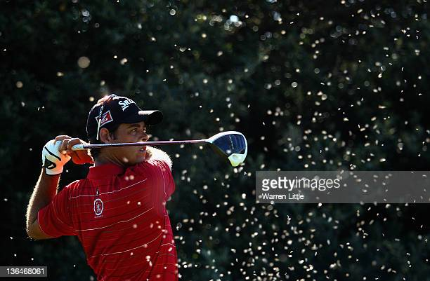 Jaco van Zyl of South Africa tees off on the 12th hole surrounded by flying ants during the second round of the Africa Open at East London GC on...