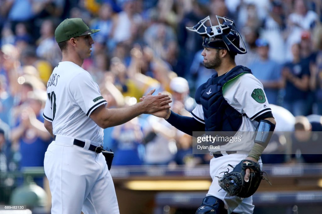 Jacob Barnes #50 and Manny Pina #9 of the Milwaukee Brewers celebrate after beating the Arizona Diamondbacks 9-5 at Miller Park on May 28, 2017 in Milwaukee, Wisconsin.