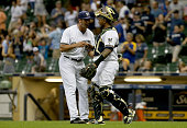 Jacob Barnes and Martin Maldonado of the Milwaukee Brewers celebrate after beating the Arizona Diamondbacks 72 at Miller Park on July 25 2016 in...