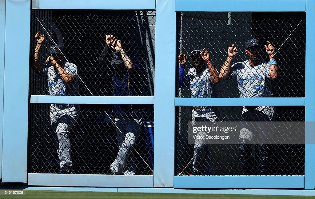 Jacob Barnes Sean Nolin and Marcus Hanel of the Milwaukee Brewers look on from the bullpen in the ninth inning during the MLB game against the Los...