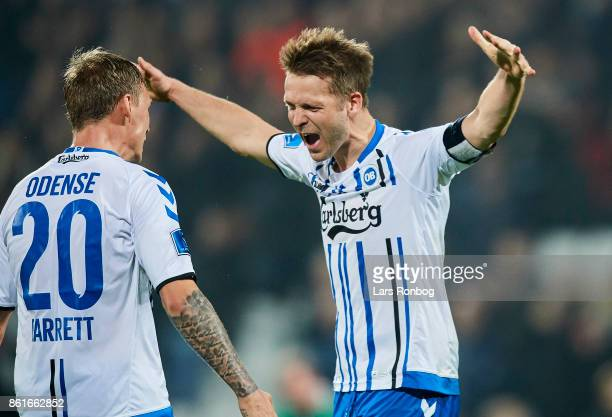 Jacob Barrett Laursen and Kenneth Emil Petersen of OB Odense celebrate after the Danish Alka Superliga match between OB Odense and FC Copenhagen at...