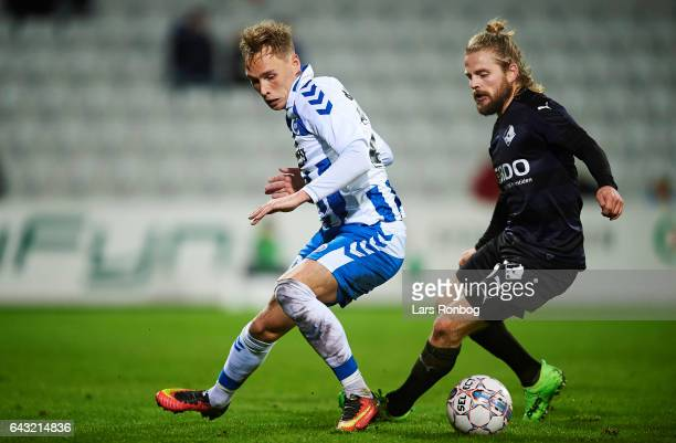 Jacob Barrett Laursen of OB Odense and Kasper Fisker of Randers FC compete for the ball during the Danish Alka Superliga match between OB Odense and...