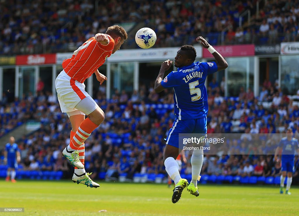 Jacob Blyth of Blackpool beats <a gi-track='captionPersonalityLinkClicked' href=/galleries/search?phrase=Gabriel+Zakuani&family=editorial&specificpeople=639100 ng-click='$event.stopPropagation()'>Gabriel Zakuani</a> of Peterborough United to score their first goal with a header during the Sky Bet League One match between Peterborough United and Blackpool at ABAX Stadium on May 8, 2016 in Peterborough, England.