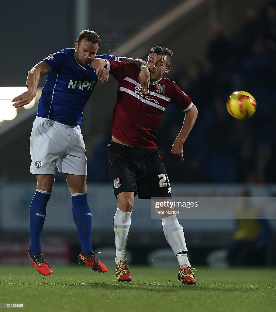 Jacob Blyth of Northampton Town challenges for the ball with Ian Evatt of Chesterfield during the Sky Bet League Two match between Chesterfield and Northampton Town at Proact Stadium on November 26, 2013 in Chesterfield, England.