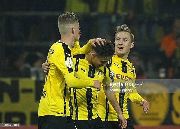 Jacob Bruun Larsen Emre Mor and Felix Passlack of Borussia Dortmund celebrate scoring a goal during the DFB Pokal soccer match between Borussia...