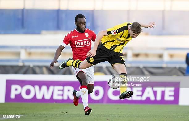 Jacob Bruun Larsen of Borussia Dortmund gets challenged by Reginal Goreux of Standard Liege during the friendly match between Borussia Dortmund and...
