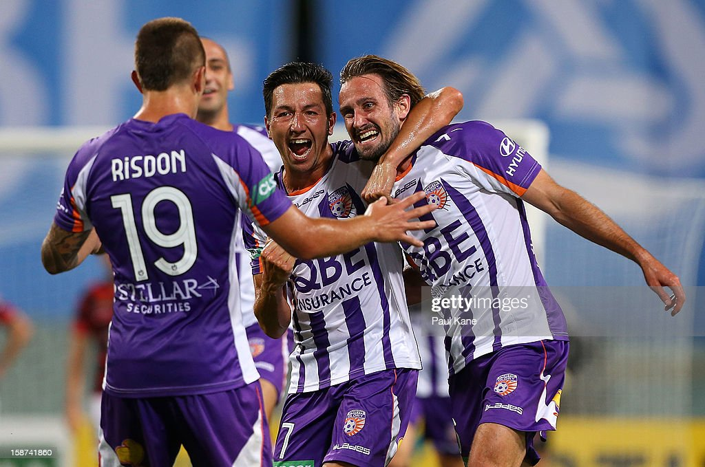 Jacob Burns and Nick Ward of the Glory celebrate scoring a goal during the round 13 A-League match between the Perth Glory and the Western Sydney Wanderers at Patersons Stadium on December 27, 2012 in Perth, Australia.