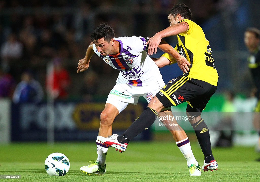 Jacob Burns of Perth and Emmanuel Muscat of wellinginton contest possession during the round eight A-League match between Perth Glory and Wellington Phoenix at NIB Stadium on November 24, 2012 in Perth, Australia.
