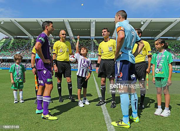 Jacob Burns of the Glory and Brett Emerton of Sydney attend the coin toss during the round four ALeague match between Perth Glory and Sydney FC at...