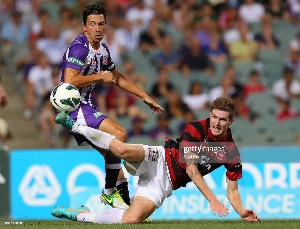 Jacob Burns of the Glory and Joey Gibbs of the Wanderers contest for the ball during the round 13 A-League match between the Perth Glory and the Western Sydney Wanderers at Patersons Stadium on December 27, 2012 in Perth, Australia.
