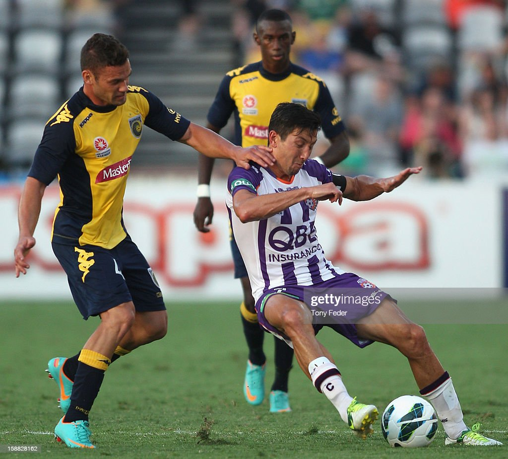 Jacob Burns of the Glory and Pedj Bojic of the Mariners contest the ball during the round 14 A-League match between the Central Coast Mariners and the Perth Glory at Bluetongue Stadium on December 31, 2012 in Gosford, Australia.