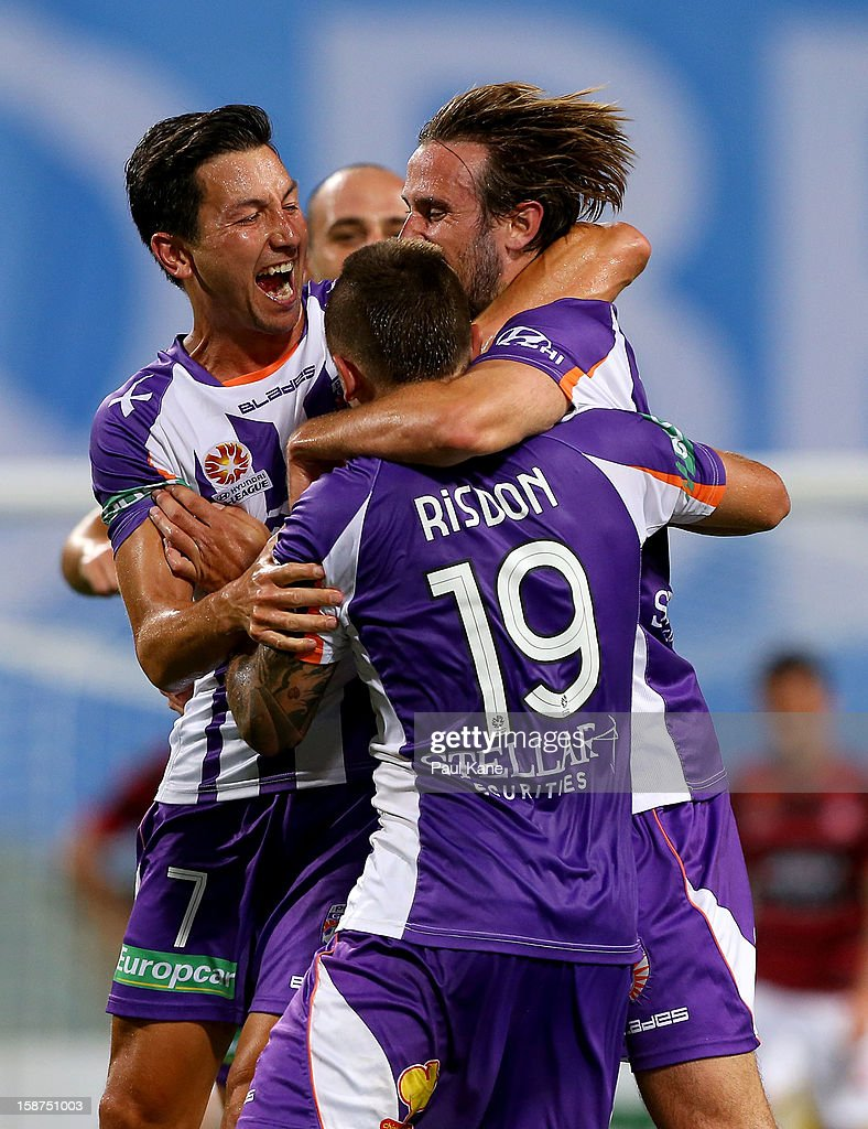 <a gi-track='captionPersonalityLinkClicked' href=/galleries/search?phrase=Jacob+Burns&family=editorial&specificpeople=2178094 ng-click='$event.stopPropagation()'>Jacob Burns</a> of the Glory celebrates an equalising goal scored by Nick Ward (R) during the round 13 A-League match between the Perth Glory and the Western Sydney Wanderers at Patersons Stadium on December 27, 2012 in Perth, Australia.