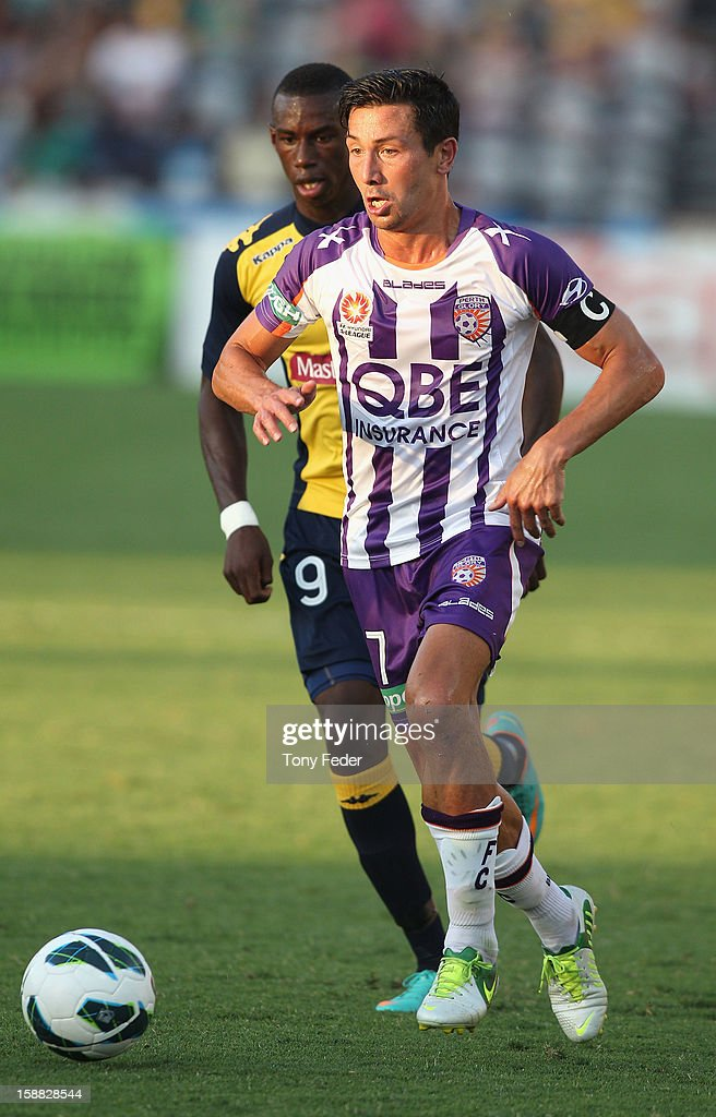 Jacob Burns of the Glory controls the ball in front of Bernie Ibini of the Mariners during the round 14 A-League match between the Central Coast Mariners and the Perth Glory at Bluetongue Stadium on December 31, 2012 in Gosford, Australia.