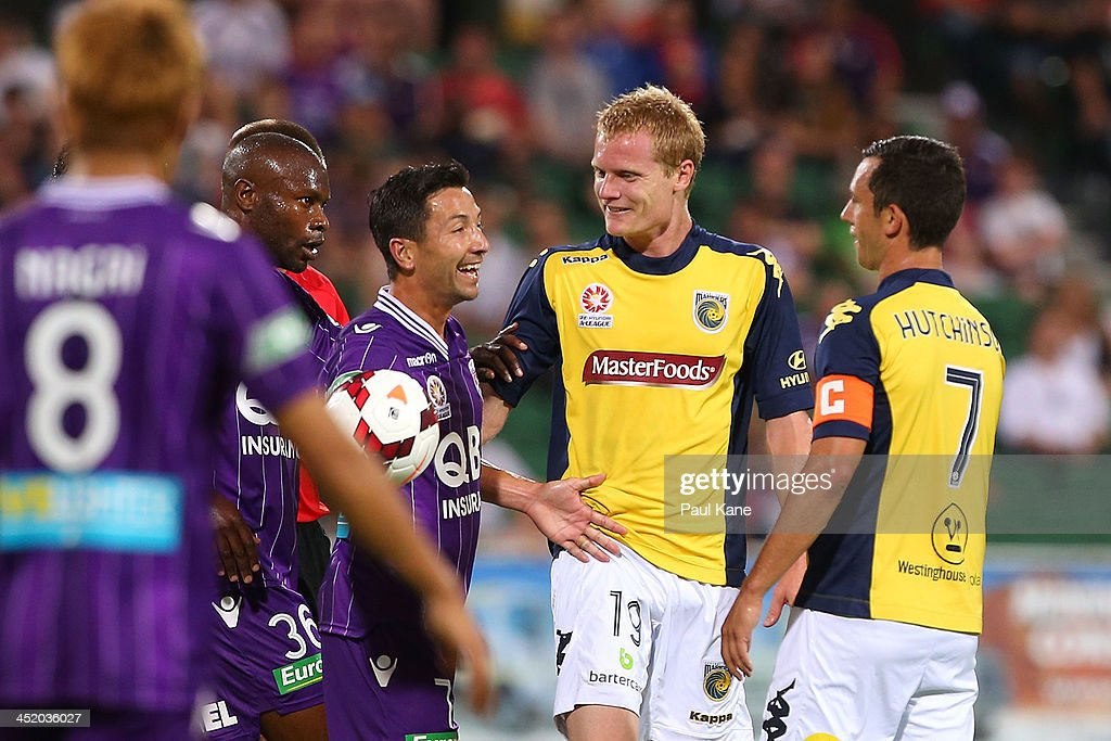 Jacob Burns of the Glory interacts with Matthew Simon and John Hutchinson of the Mariners during the round seven A-League match between Perth Glory and the Central Coast Mariners at nib Stadium on November 23, 2013 in Perth, Australia.