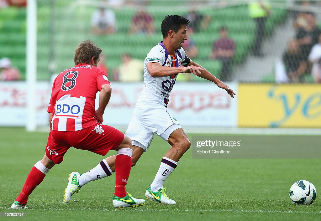 Jacob Burns of the Glory is pressured by Matt Thompson of the Heart during the round 10 A-League match between the Melbourne Heart and the Perth Glory at AAMI Park on December 8, 2012 in Melbourne, Australia.