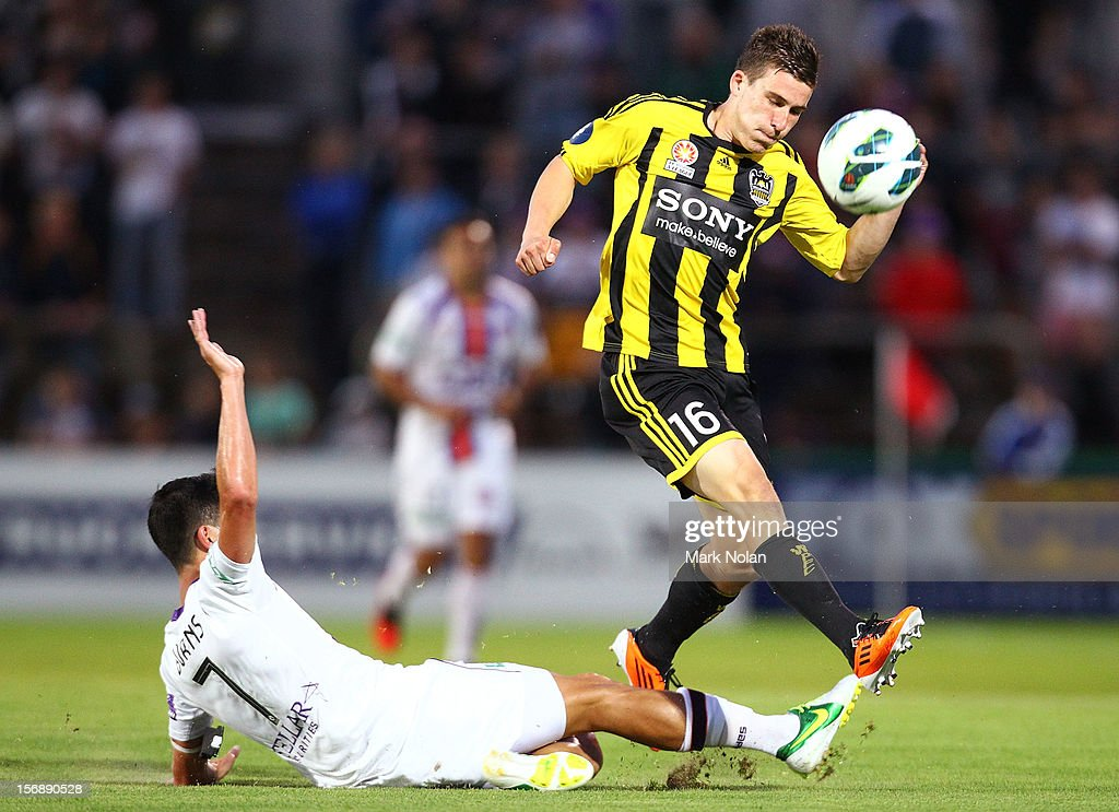Jacob Burns of the Glory tackles Louis Fenton of Wellington during the round eight A-League match between Perth Glory and Wellington Phoenix at NIB Stadium on November 24, 2012 in Perth, Australia.
