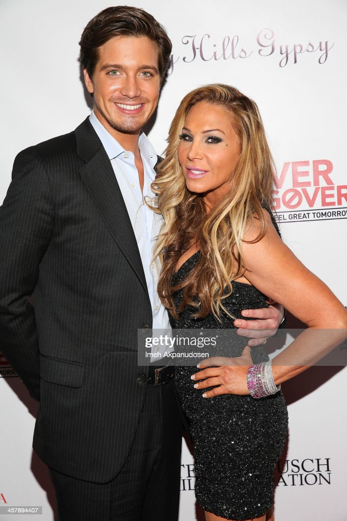 Jacob Busch (L) and television personality Adrienne Maloof attend The Maloof Foundation And Jacob's Peter W. Busch Family Foundation hosting a holiday toy donation For Children's Hospital on December 18, 2013 in Beverly Hills, California.