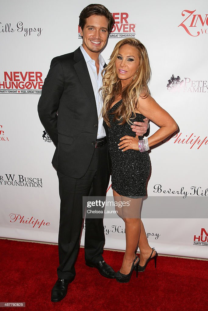 Jacob Busch (L) and TV personality Adrienne Maloof arrive at The Maloof Foundation and Jacob's Peter W. Busch family foundation holiday toy donation on December 18, 2013 in Beverly Hills, California.