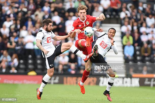 Jacob Butterfield and Marcus Olsson of Derby County and Sam Gallagher of Blackburn in action during the Sky Bet Championship match between Derby...