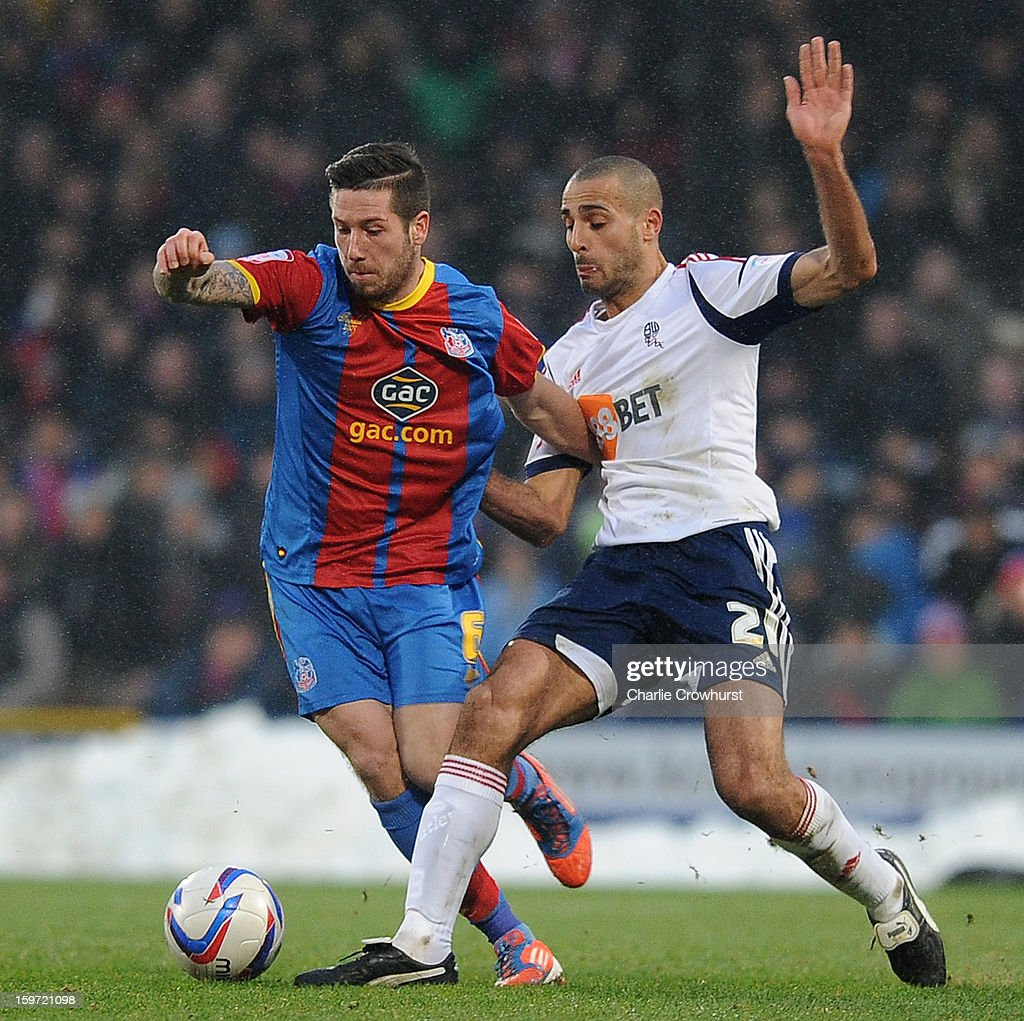 Jacob Butterfield of Crystal Palace holds of Bolton's Darren Pratley during the npower Championship match between Crystal Palace and Bolton at Selhurst Park on January 19, 2013 in London England.