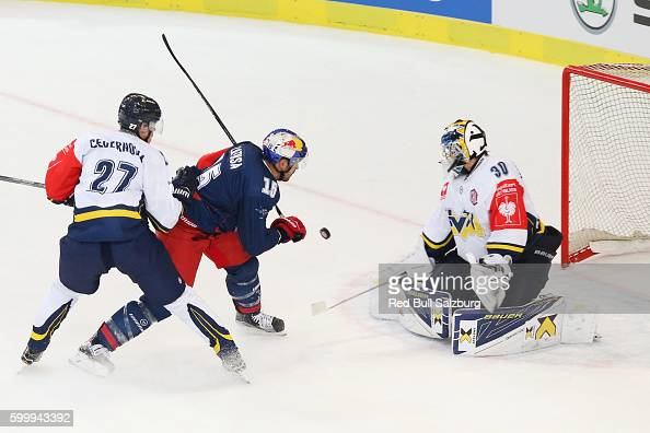 Jacob Cederholm of HV71 Jonkoping Manuel Latusa of EC Red Bull Salzburg and Linus Soderstrom of HV71 Jonkoping during the Champions Hockey League...