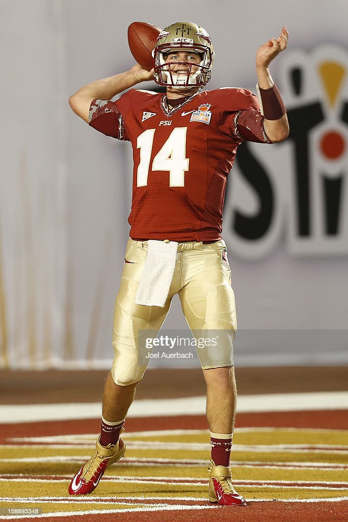Jacob Coker #14 of the Florida State Seminoles throws the ball prior to the game against the Northern Illinois Huskies during the 2013 Discover Orange Bowl at Sun Life Stadium on January 1, 2013 in Miami, Florida. The Seminoles defeated the Huskies 31-10.