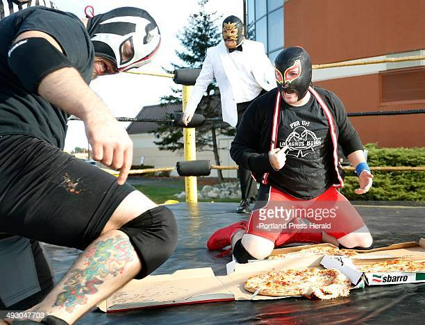 Jacob Cote 'Magnus Buho' right and Antoine Malaab 'Diablo Blanco' both from Portland and of Super Lucha Explosiva argue about who won their Pizza...