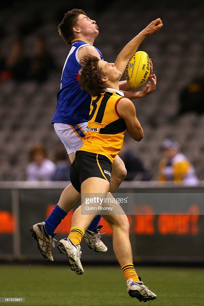 Jacob Crowe of the Ranges marks over the top of Joshua Newman of the Stingrays during the TAC Cup final match between Eastern Ranges and the Dandenong Southern Stingrays at Etihad Stadium on September 22, 2013 in Melbourne, Australia.
