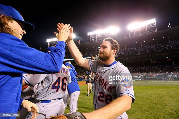 Jacob deGrom and Daniel Murphy of the New York Mets celebrate on the field after winning Game 4 of the NLCS against the Chicago Cubs at Wrigley Field...
