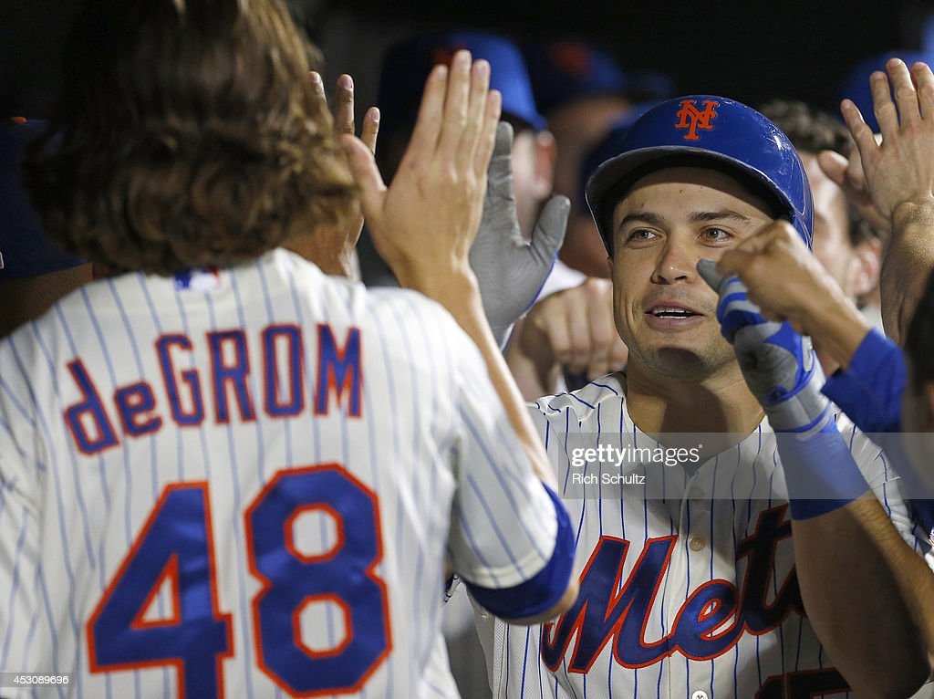 <a gi-track='captionPersonalityLinkClicked' href=/galleries/search?phrase=Jacob+deGrom&family=editorial&specificpeople=12510601 ng-click='$event.stopPropagation()'>Jacob deGrom</a> #48 congratulates teammate Travis d'Arnaud #15 of the New York Mets who hit a sacrafice fly that scored Daniel Murphy #28 in the seventh inning against the San Francisco Giants on August 2, 2014 at Citi Field in the Flushing neighborhood of the Queens borough of New York City.