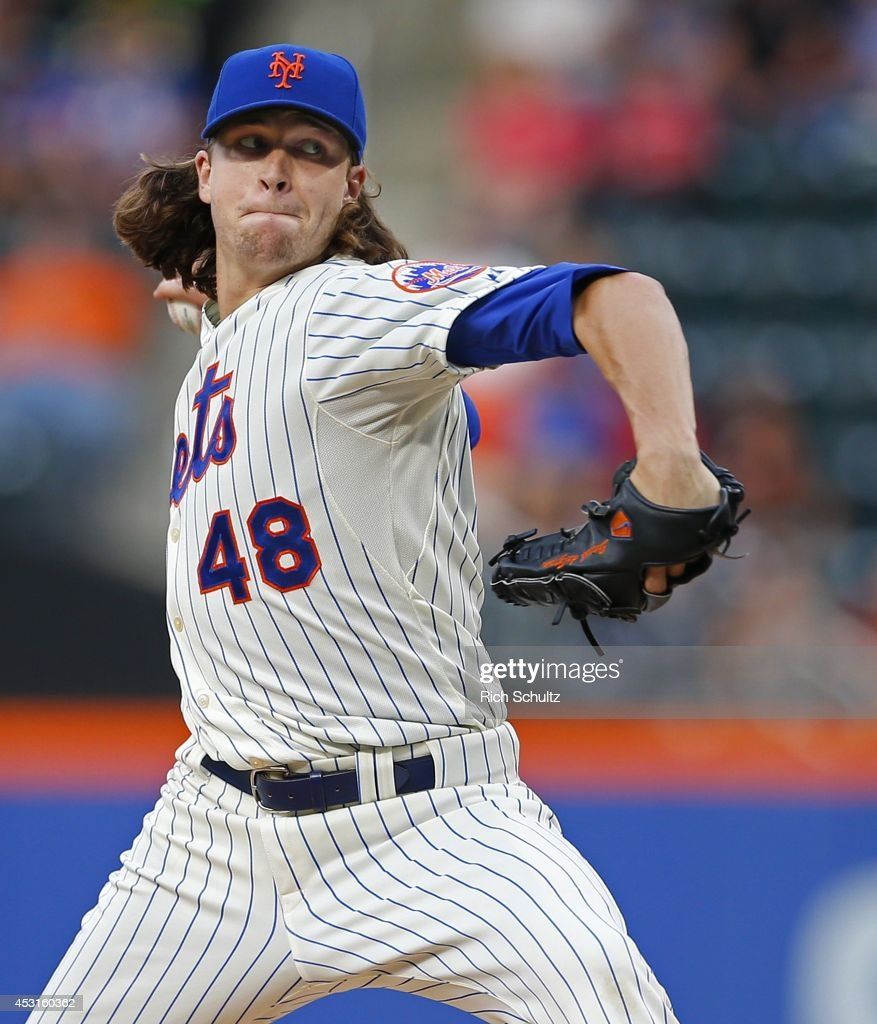 Jacob deGrom #48 of the New York Mets delivers a pitch against the San Francisco Giants on August 2, 2014 at Citi Field in the Flushing neighborhood of the Queens borough of New York City.