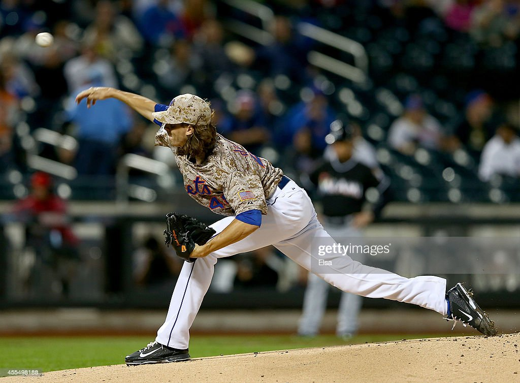 Jacob deGrom of the New York Mets delivers a pitch in the first inning against the Miami Marlins on September 15 2014 at Citi Field in the Flushing...