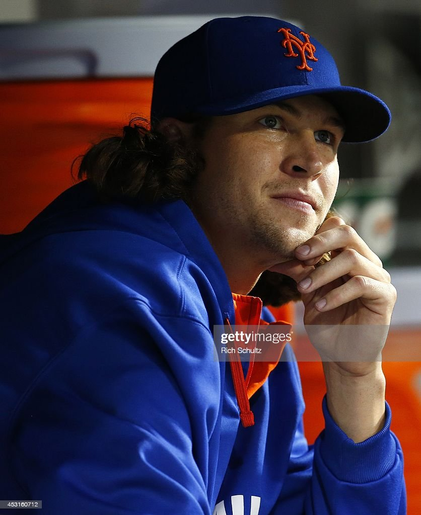 Jacob deGrom #48 of the New York Mets in the dugout during a game against the San Francisco Giants on August 2, 2014 at Citi Field in the Flushing neighborhood of the Queens borough of New York City.