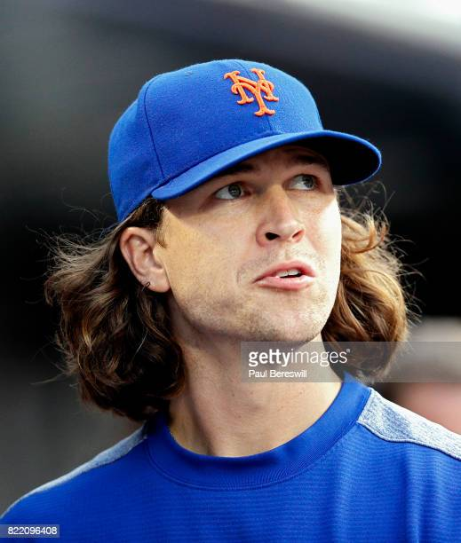 Jacob deGrom of the New York Mets looks over from the dugout in an interleague MLB baseball game against the Oakland Athletics on July 21 2017 at...