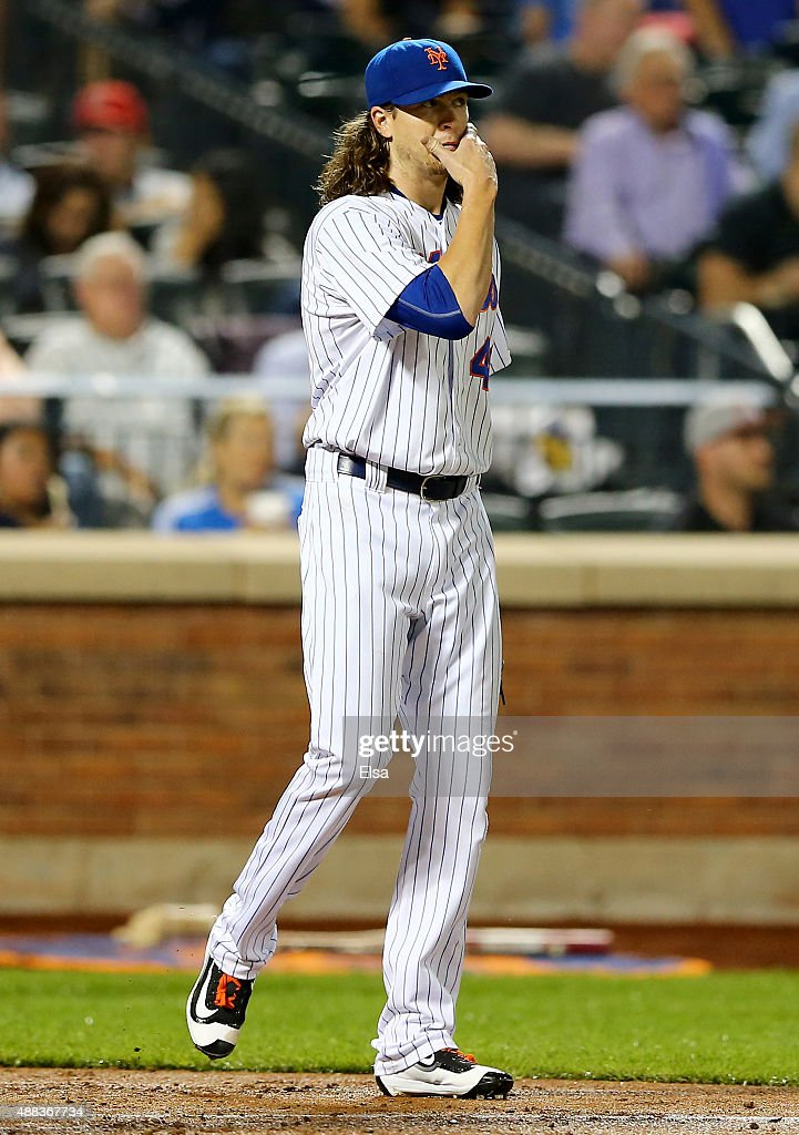 Jacob deGrom of the New York Mets reacts after Justin Bour of the Miami Marlins scored in the fourth inning on September 15 2015 at Citi Field in the...