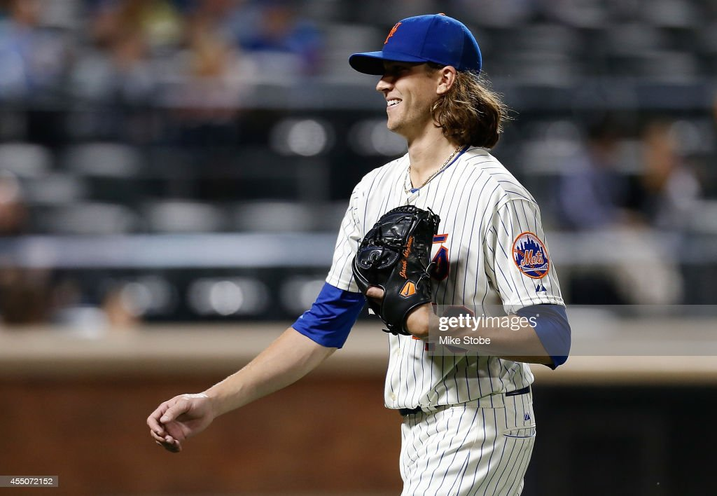 Jacob deGrom of the New York Mets smiles as he walks off the mound in the sixth inning against the Colorado Rockies at Citi Field on September 9 2014...