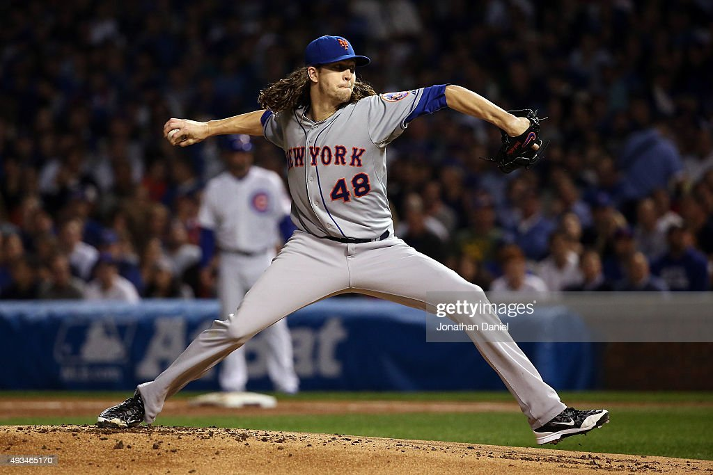 Jacob deGrom of the New York Mets throws a pitch in the first inning against the Chicago Cubs during game three of the 2015 MLB National League...