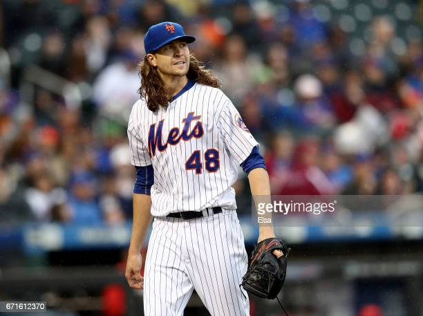 Jacob deGrom of the New York Mets walks back to the dugout after the fifth inning against the Washington Nationals on April 22 2017 at Citi Field in...