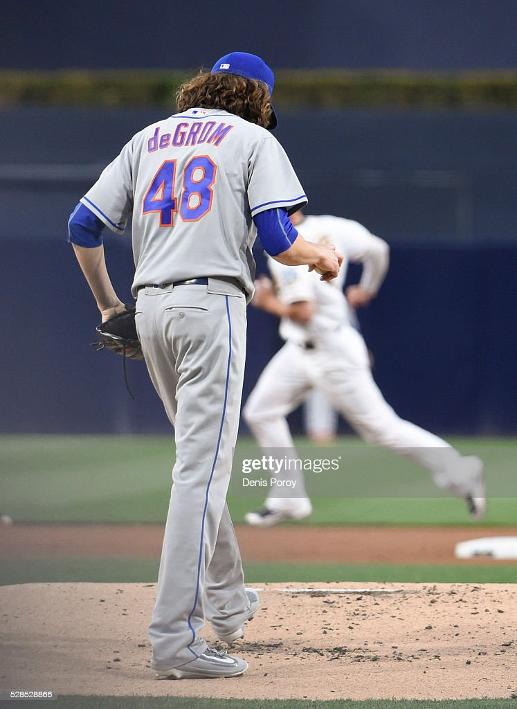<a gi-track='captionPersonalityLinkClicked' href=/galleries/search?phrase=Jacob+deGrom&family=editorial&specificpeople=12510601 ng-click='$event.stopPropagation()'>Jacob deGrom</a> #48 of the New York Mets walks back to the mound after giving up a solo home run to Wil Myers #4 of the San Diego Padres during the first inning of a baseball game at PETCO Park on May 5, 2016 in San Diego, California.